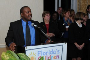 Former foster child Mez Pierre addresses attendees at the recent Florida's Children First event.