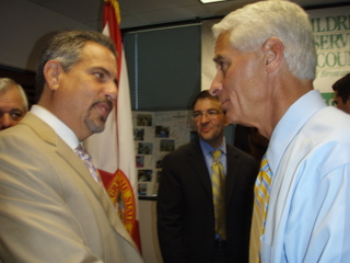 Child advocate attorney Howard Talenfeld greets Florida Gov. Charlie Crist at the historic signing ceremony.