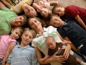 With eight of her nine children, Peggy Bach holds her newest child, Israel Bach,1 week old. Others are from the baby, clockwise, Andrew Bach, Grace Fisher, Arik Bach, Amber Hurley, Faith Fisher, Jake Bach and Bruce Bach. DON BURK/The Times-Union